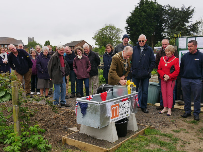 The Mayor of Ely celebrates the water installation at three sites.